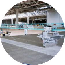 Pisos em Concreto com Aspersão de Agregados Minerais e Metálicos Utilizando Spreader